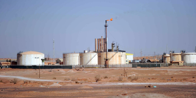 A general view shows an oil installation on the outskirts of In Amenas, deep in the Sahara near the Libyan border, on January 18, 2013. Islamist hostage-takers at a nearby gas field in the area, more than 1,300 kms southeast of the capital Algiers, demanded a prisoner swap and an end to the French military campaign in Mali, a report said, while 30 foreigners were reported still missing in the worst international hostage drama for years. AFP PHOTO/FAROUK BATICHE        (Photo credit should read F