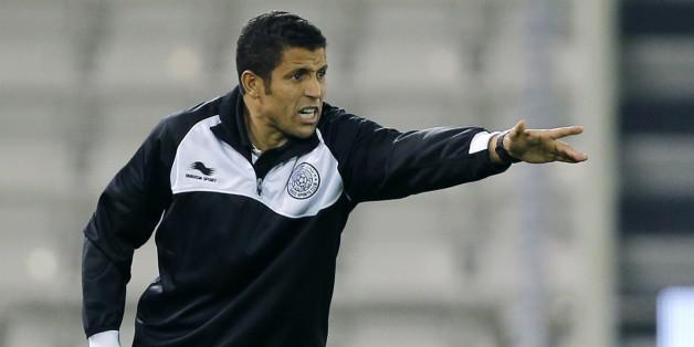 Al-Sadd's head coach AlHussein Ammouta gestures during the Qatar Stars League soccer match against Al-Rayyan in Doha February 19, 2013. REUTERS/Fadi Al-Assaad (QATAR - Tags: SPORT SOCCER)