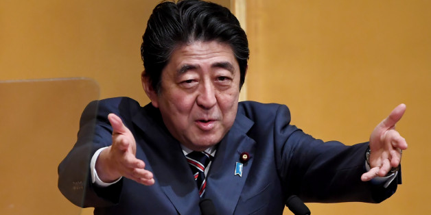 Japanese Prime Minister Shinzo Abe gestures while delivering his speech at a lecture hosted by the Naigai Josei Chosakai, or 'Investigation group on domestic and international affairs' in Tokyo on December 20, 2016. / AFP / TOSHIFUMI KITAMURA        (Photo credit should read TOSHIFUMI KITAMURA/AFP/Getty Images)