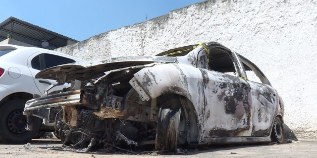 Grab taken from an AFP video showing the burned-out rental car of missing Greek ambassador to Brazil Kyriakos Amiridis, at a parking lot outside the police station in Belford Roxo, in the Brazilian state of Rio de Janeiro, on December 30, 2016, a day after it was found with a body inside.