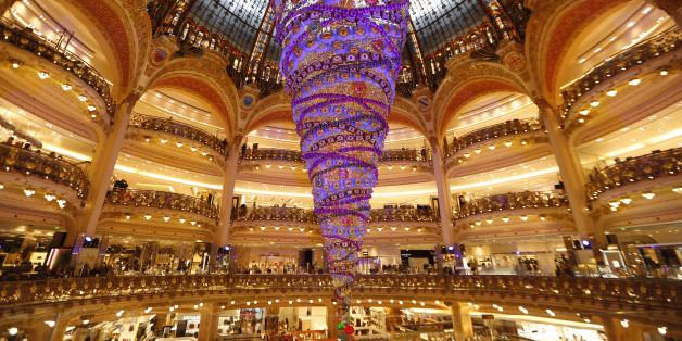 A giant Christmas tree installed upside down stands in the middle of the Galeries Lafayette department store in Paris ahead of the holiday season in the French capital, November 6, 2014.  REUTERS/Charles Platiau   (FRANCE - Tags: SOCIETY BUSINESS)