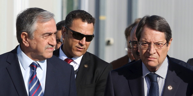 U.N. member of the Committee on Missing Persons (CMP) Paul Henri Arni (R) talks with Greek Cypriot leader and Cyprus President Nicos Anastasiades (C) and Turkish Cypriot leader Mustafa Akinci outside the CMP Anthropological Laboratory in the buffer zone of Nicosia airport December 20, 2015. REUTERS/Yiannis Kourtoglou