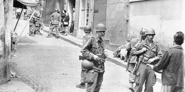 (Original Caption) French make house-to-house search in Casbah. Algiers, Algeria: French soldiers in full battle dress are shown during a house-to-house search in the Casbah, the old Moslem quarter of Algeria where some 50,000 natives live. Six thousand French soldiers made the surprise raid on the area searching for rebel arms and equipment while helicopters hovered overhead to observe any movement in the sealed off sector. More than 200 men carrying arms were arrested and 2,000 Moslems were he