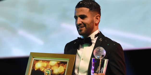Algerian and Leicester forward Riyad Mahrez poses for a photo after being crowned African Footballer of the Year in Abuja, on January 5, 2017. Algerian and Leicester striker Riyad Mahrez has been crowned the CAF African best Footballer for 2016 and beating former best player and Gabonese forward Pierre-Emerick  Aubameyang  and Sehegalese striker Sadio Mane, for the continent's most prestigious individual award. / AFP / PIUS UTOMI EKPEI        (Photo credit should read PIUS UTOMI EKPEI/AFP/Getty