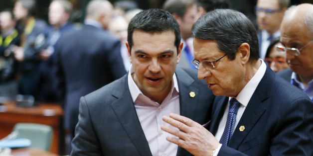 Greece's Prime Minister Alexis Tsipras listens to Cyprus' President Nicos Anastasiades (R) during a European Union leaders summit in Brussels March 19, 2015.      REUTERS/Francois Lenoir