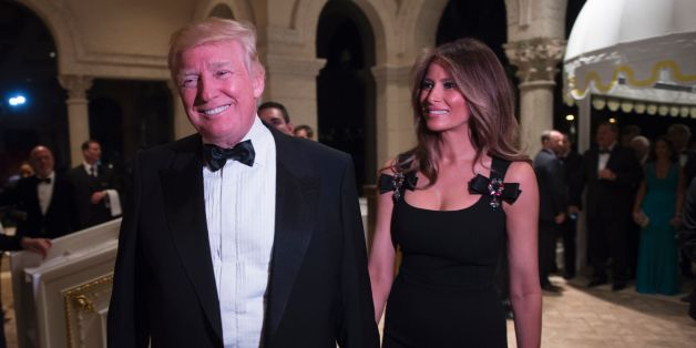US President-elect Donald Trump arrives with his wife Melania for a New Year's Eve party December 31, 2016 at Mar-a-Lago in Palm Beach, Florida. / AFP / DON EMMERT        (Photo credit should read DON EMMERT/AFP/Getty Images)