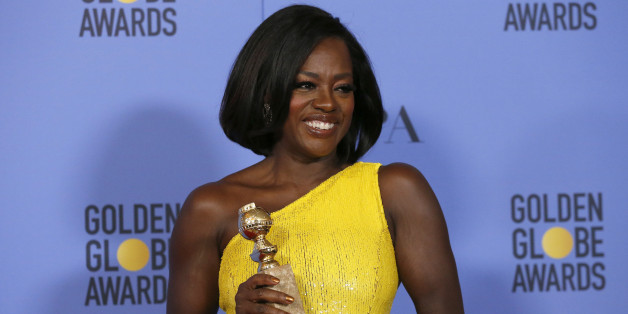 "Viola Davis holds the award for Best Performance by an Actress in a Supporting Role in any Motion Picture for her role in ""Fences"" during the 74th Annual Golden Globe Awards in Beverly Hills, California, U.S., January 8, 2017.   REUTERS/Mario Anzuoni"