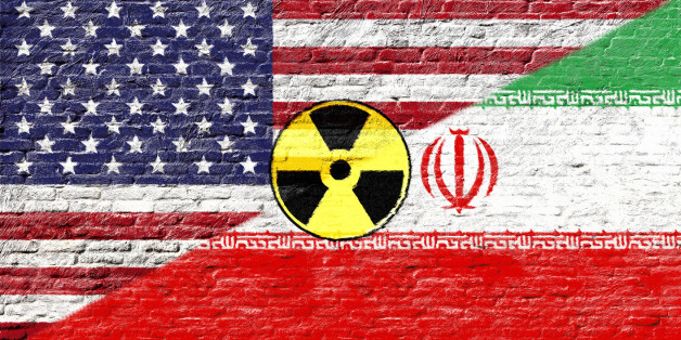 United states and Iran - National flags on Brick wall with nuclear icon