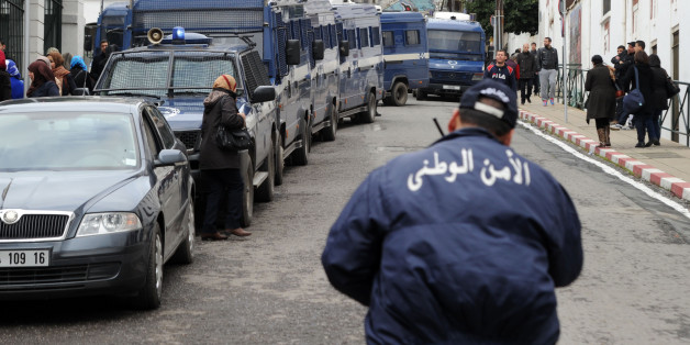Algerian police are deployed in the street during a protest against Algerian President Abdelaziz Bouteflika running in the April presidential elections in  Algiers on March 1, 2014. Bouteflika, who has been in power since 1999, will run for a fourth term in April, despite his health problems which are fueling doubts about his ability to lead the country. AFP PHOTO / FAROUK BATICHE        (Photo credit should read FAROUK BATICHE/AFP/Getty Images)