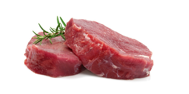 Two Raw Steaks Isolated on White