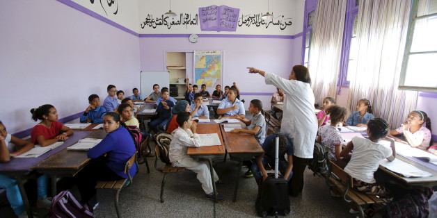 Schoolchildren listen to a teacher as they study during a class in the Oudaya primary school in Rabat, September 15, 2015, at the start of the new school year in Morocco. Nearly three years after Taliban gunmen shot Pakistani schoolgirl Malala Yousafzai, the teenage activist last week urged world leaders gathered in New York to help millions more children go to school. World Teachers' Day falls on 5 October, a Unesco initiative highlighting the work of educators struggling to teach children amid