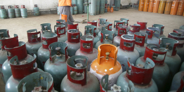 A worker carries a cylinder of Liquefied Petroleum Gas (LPG) in Foshan, Guangdong province, October 20, 2008. China is the biggest consumer of LPG, a compressed mix of propane and butane, used for heating and transport, and now increasingly being considered for making petrochemicals in the world's second-biggest economy. As demand in China soars, the U.S. shale boom has led to a surge in production of LPG, which is bringing down global prices and challenging established suppliers in the Middle E