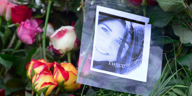 BAD SODEN-SALMUENSTER, GERMANY - DECEMBER 03:  A picture of Tugce and flowers pictured at the grave of Tugce Albayrak, the 23-year-old university student who died after she was attacked in a McDonald's restaurant parking lot, on December 3, 2014 in Bad Soden-Salmuenster, Germany. Tugce intervened at a McDonald's restaurant in Giessen when two teenaged girls were being accosted by men in the bathroom of the restaurant on November 22. One of the men, Sanel M., reportedly waited for her in the park