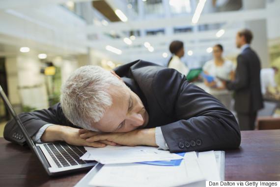 sleeping worker desk