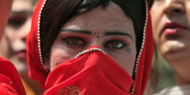 A Pakistani transvestite takes a part in a rally with others to support their arrested colleague Raani, whose real name was given as Kashif, in Peshawar June 3, 2010. Pakistani police arrested what they said last week was an entire wedding party at a ceremony between a man and a transvestite, accusing the pair of promoting homosexuality in the devoutly Muslim country. REUTERS/Fayaz Aziz   (PAKISTAN - Tags: POLITICS CIVIL UNREST SOCIETY)