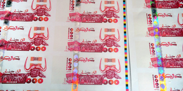 A picture taken on October 26, 2009 in Lyon, central France shows plates of false printed Algerian Dinar banknotes, shown during a press conference given after the police broke up a network of counterfeit currency. Twelve people were jailed and indicted on October 25, but the network has already used at least 200,000 banknotes of 1,000 dinars, or nearly 2 million Euros, said judicial police.  AFP PHOTO PHILIPPE MERLE (Photo credit should read PHILIPPE MERLE/AFP/Getty Images)