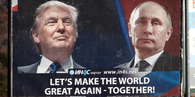 Pedestrians cross the street behind a billboard showing a pictures of  US president-elect Donald Trump and Russian President Vladimir Putin in Danilovgrad, Montenegro, November 16. 2016. REUTERS/Stevo Vasiljevic