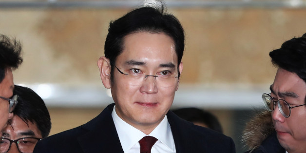 Jay Y. Lee, co-vice chairman of Samsung Electronics Co., center, is surrounded by members of the media as he arrives at the special prosecutors' office in Seoul, South Korea, on Thursday, Jan. 12, 2017. Special prosecutors began questioning Lee on Thursday as a suspect in a bribery investigation, deepening an influence-peddling scandal that has already led to the impeachment of South Korea's president. Photographer: SeongJoon Cho/Bloomberg via Getty Images