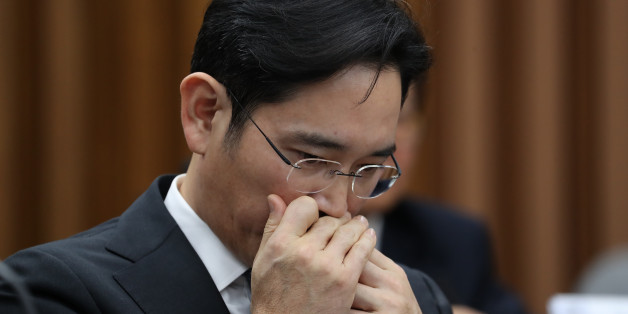 Jay Y. Lee, co-vice chairman of Samsung Electronics Co., applies lip-balm during a parliamentary hearing at the National Assembly in Seoul, South Korea, on Tuesday, Dec. 6, 2016. Lee, the de-facto head of Samsung, became the focus of the hearing of South Korea's top tycoons in connection with a widening influence-peddling scandal that may cost the country's president her job. Photographer: SeongJoon Cho/Bloomberg via Getty Images