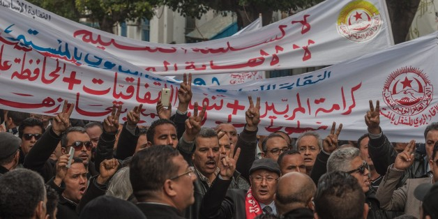 TUNIS, TUNISIA - NOVEMBER 29: A group of teachers gathered in front of the National Education Ministry march to Al-Kasaba square, where the state house is, during a protest against the government's 2017 budget in Tunis, Tunisia on November 29, 2016. Protestors demanded the resignation of the National Education Minister Neji Jalloul.  (Photo by Amine Landoulsi/Anadolu Agency/Getty Images)