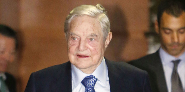U.S. investor George Soros completes a meeting with Prime Minister Shinzo Abe in Tokyo on Jan. 6, 2017. (Photo by Kyodo News via Getty Images)