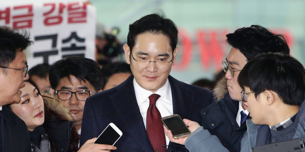 Lee Jae Yong, vice chairman of Samsung Electronics Co., speaks to reporters as he appears at the South Korean special prosecutor's office in Seoul on Jan. 12, 2017, for questioning over the Samsung group's alleged financial support for President Park Geun Hye's confidante Choi Soon Sil in return for business favors. (Photo by Pool/Kyodo News via Getty Images)