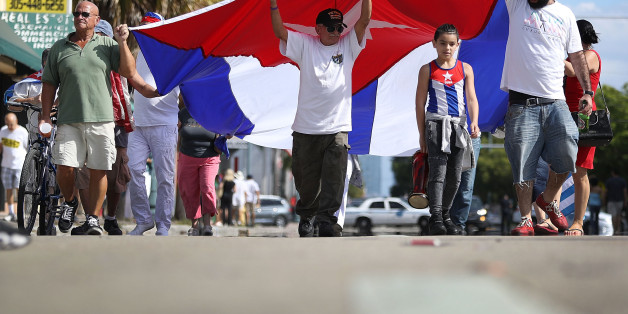 MIAMI, FL - NOVEMBER 26:  People hold a Cuban flag in the streets as they react to the news of the death of former Cuban President Fidel Castro outside the restaurant Versailles on November 26, 2016 in Miami, Florida. Many, mostly Cubans, gathered to wave flags and celebrate the news of the death of the Cuban revolutionary who died at 90.  (Photo by Joe Raedle/Getty Images)