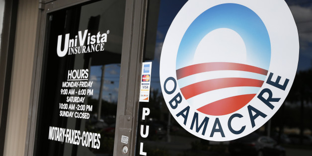 An Obamacare logo is shown on the door of the UniVista Insurance agency in Miami, Florida on January 10, 2017. 