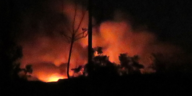 A general view shows flames and smoke at the Mezzah military airport on the southwestern outskirts of the capital Damascus following an explosion early on January 13, 2017.                          The Syrian army said that Israeli missile strikes caused a series of explosions at an airbase outside Damascus before dawn. The Israeli army had no comment on the strikes when contacted by AFP earlier on January 13, 2017. / AFP / -        (Photo credit should read -/AFP/Getty Images)