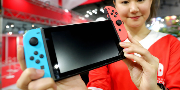 TOKYO, JAPAN - JANUARY 13:  (CHINA OUT, SOUTH KOREA OUT) A staff displays the new game console 'Nitendo Switch' during its unveiling event on January 13, 2017 in Tokyo, Japan. The console will be on sale on March 3 in Japan, United States and Europe at the price of 300 U.S. dollars.  (Photo by The Asahi Shimbun via Getty Images)