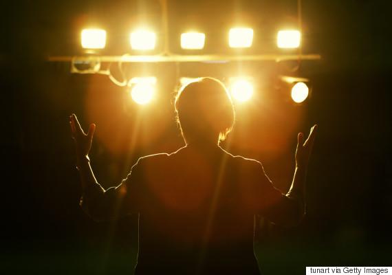 woman alone on stage speech