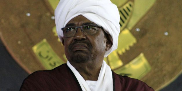Sudanese President Omar al-Bashir (C) looks on during a celebration to mark the 61st anniversary of Sudans independence from Britain, at the presidential palace in Khartoum, on December 31, 2016. / AFP / ASHRAF SHAZLY        (Photo credit should read ASHRAF SHAZLY/AFP/Getty Images)