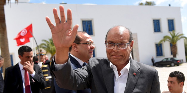Former Tunisian president Moncef Marzouki arrives to take part in an anti-extremism march in Tunis March 29, 2015. World leaders joined tens of thousands of Tunisians on Sunday to march in solidarity against Islamist militants, a day after security forces killed members of a group blamed for a deadly museum attack.  REUTERS/Emmanuel Dunand/Pool