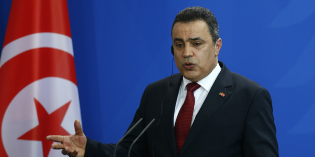 Tunisia's Prime Minister Mehdi Jomaa speaks during a news conference after talks with German Chancellor Angela Merkel at the Chancellery in Berlin, June 18, 2014. REUTERS/Thomas Peter (GERMANY - Tags: POLITICS)