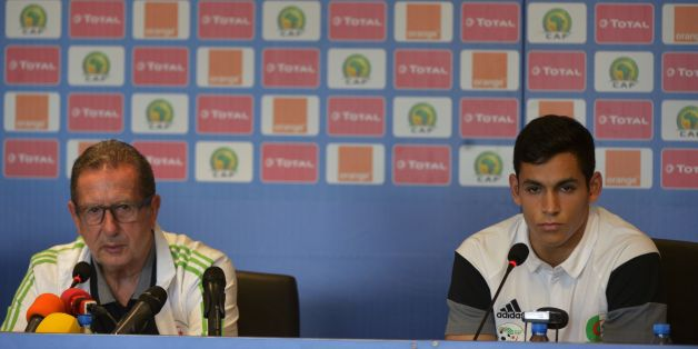 Algeria's Belgian Coach Georges Leekens and player Aissa Mandi give a press conference at Franceville stadium in Franceville on January 14, 2017, ahead of Africa Cup of Nations (CAN). / AFP / KHALED DESOUKI        (Photo credit should read KHALED DESOUKI/AFP/Getty Images)