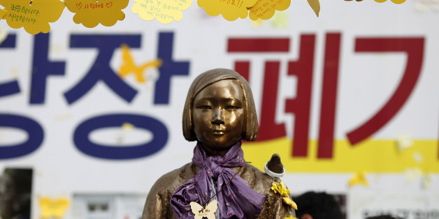 SEOUL, SOUTH KOREA - AUGUST 14:  The Statue of Girl stands on the Peace Road, in front of Japanese Embassy on August 14, 2016 in Seoul, South Korea. The activists held a ceremony to mark the 25th anniversary of Kim Hak-sun's comfort women testimony amid the talks between ministers of Japan and South Korea are in progress on the details how $9.9 million funds be spent for Reconciliation and Healing Foundation for the surviving comfort women.  (Photo by Woohae Cho/Getty Images)