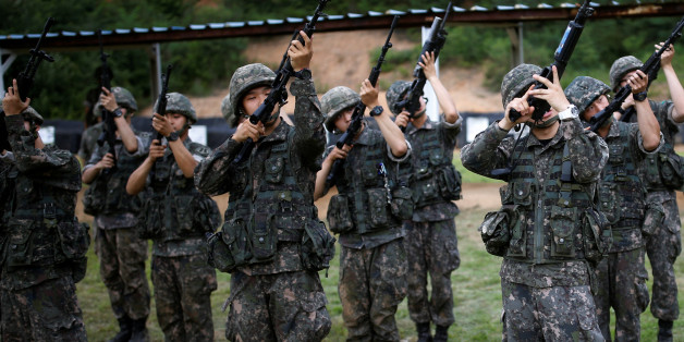 """South Korean soldiers take part in a firearms training at a military base near the demilitarized zone separating the two Koreas in Paju, South Korea, July 13, 2016.  REUTERS/Kim Hong-Ji SEARCH """"BALLET SOLDIERS"""" FOR THIS STORY. SEARCH """"THE WIDER IMAGE"""" FOR ALL STORIES. TPX IMAGES OF THE DAY"""