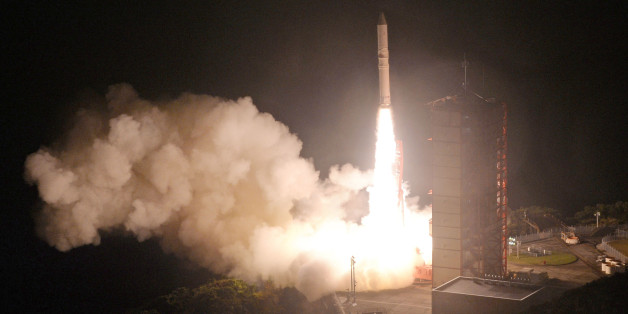 Japan's upgraded solid fuel Epsilon rocket lifts off from the Uchinoura Space Center in the town of Kimotsuki in Kagoshima Prefecture, southwestern Japan, around 8 p.m. on Dec. 20, 2016. The ERG satellite carried by the rocket was successfully released about 13 minutes later. (Photo by Kyodo News via Getty Images)