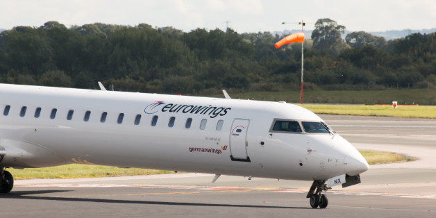 Manchester, United Kingdom - August 27, 2015: Eurowings Bombardier CRJ900 NextGen passenger plane taxiing on Manchester International Airport after landing.