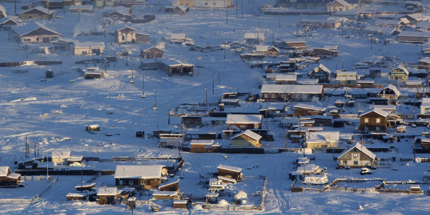 A general view of the village of Tomtor in the Oymyakon valley, in the Republic of Sakha, northeast Russia, January 28, 2013. The coldest temperatures in the northern hemisphere have been recorded in Sakha, the location of the Oymyakon valley, where according to the United Kingdom Met Office a temperature of -67.8 degrees Celsius (-90 degrees Fahrenheit) was registered in 1933 - the coldest on record in the northern hemisphere since the beginning of the 20th century. Yet despite the harsh climate, people live in the valley, and the area is equipped with schools, a post office, a bank, and even an airport runway (albeit open only in the summer). Picture taken January 28, 2013.  REUTERS/Maxim Shemetov (RUSSIA - Tags: SOCIETY CITYSCAPE ENVIRONMENT)