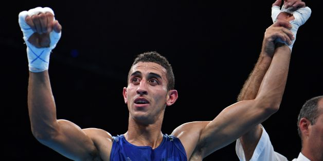 Algeria's Mohamed Flissi reacts after winning against Bulgaria's Daniel during the Men's Fly (52kg) match at the Rio 2016 Olympic Games at the Riocentro - Pavilion 6 in Rio de Janeiro on August 15, 2016.   / AFP / Yuri CORTEZ        (Photo credit should read YURI CORTEZ/AFP/Getty Images)