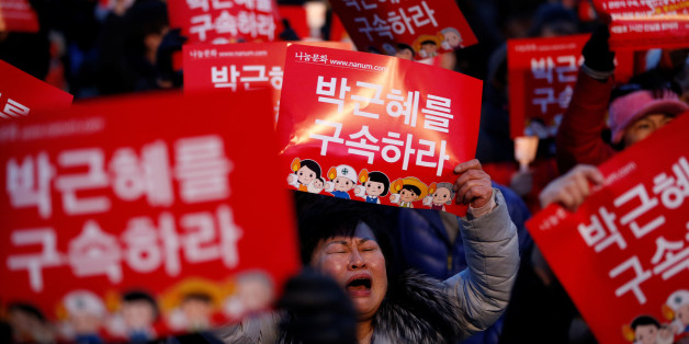"People attend a protest demanding South Korean President Park Geun-hye's resignation in Seoul, South Korea December 17, 2016. The signs read ""Arrest Park Geun-hye"". REUTERS/Kim Hong-Ji"