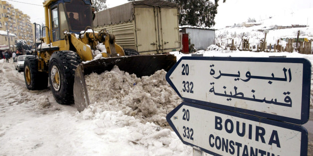 A tractor clears the snow off the road on the outskirts of the Algerian capital Algiers, January 27,2005, as the heaviest snow in more than 50 years fell on Thursday. Several areas in the north, in particular the Mediterranean oil port city of Skikda, were cut off after two days of snow, strong winds and rain. In the last 24 hours 13 people have died and 47 others have been injured, mostly in road accidents. REUTERS/ Louafi Larbi  DL/DL