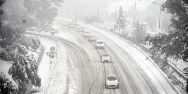 Cars drive on snow on February 4, 2012 on a highway on the outskirts of Algiers after a snowfall.    AFP PHOTO / FAROUK BATICHE (Photo credit should read FAROUK BATICHE/AFP/Getty Images)