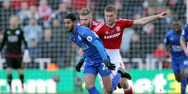 Leicester City's Riyad Mahrez (left) and Middlesbrough's Ben Gibson (right) battle for the ball during the Premier League match at the Riverside Stadium, Middlesbrough. (Photo by Richard Sellers/PA Images via Getty Images)
