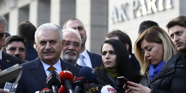 ANKARA, TURKEY - JANUARY 17: Turkish Prime Minister and the leader of Turkey's ruling party, Justice and Development Party (AK Party) Binali Yildirim (C) speaks to media before attending his party's Central Executive Board (MYK) meeting in Ankara, Turkey on January 17, 2017.  (Photo by Murat Kula/Anadolu Agency/Getty Images)
