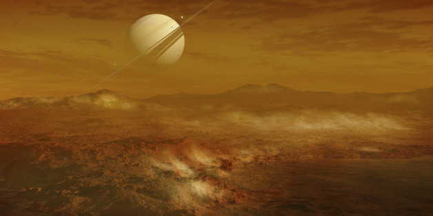 Saturn is seen here in the background from the enigmatic moon Titan, which is the second largest moon in the solar system, with a diameter of about 5 150 km. It has a highly thick, orange atmosphere that covers the entire surface. There are many different kinds of carbohydrates in the atmosphere, but nitrogen is the dominant substance.   Here you see a lake of ethane, and some freshly fallen ice on the surface. In actuality the atmosphere is so thick you would not be able to see Saturn this clearly.