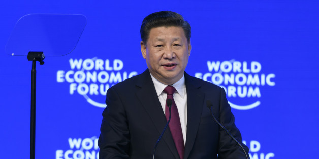 China's President Xi Jinping delivers a speech during the first day of the World Economic Forum, on January 17, 2017 in Davos.         Chinese President Xi Jinping said on January 17, 2017 that there is 'no point' in blaming economic globalisation for the world's problems. The leader of the world's second largest economy made the comment at the World Economic Forum, where he is making his first appearance as China seeks to play a greater role in world trade regimes amid rising protectionism in the US and Europe. The global elite begin a week of earnest debate and Alpine partying in the Swiss ski resort of Davos, in a week bookended by two presidential speeches of historic import. / AFP / FABRICE COFFRINI        (Photo credit should read FABRICE COFFRINI/AFP/Getty Images)