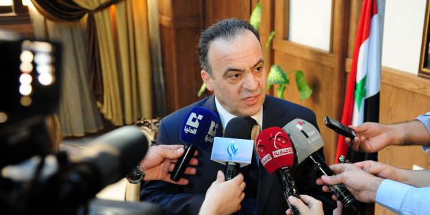 A picture taken on May 11, 2013 shows former electricity minister and newly-appointed Prime Minister Imad Khamis answering journalists' questions following a meeting in the Syrian capital Damascus.Syrian President Bashar al-Assad named Imad Khamis as the new prime minister of the war-ravaged country on June 22, 2016 and tasked him with forming a new government, the official news agency SANA reported. / AFP / STR        (Photo credit should read STR/AFP/Getty Images)