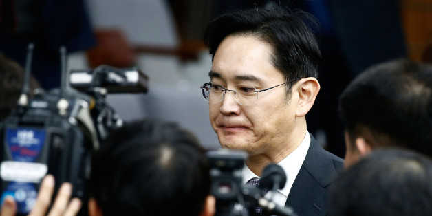 SEOUL, SOUTH KOREA - DECEMBER 06:  Lee Jae-Yong, vice chairman of Samsung leaves to adjourn for lunch during a parliamentary hearing over the Choi Soon-sil gate probe at the National Assembly on December 6, 2016 in Seoul, South Korea. South Korea started the parliament hearing with leaders of nine South Korean conglomerates including Samsung, Hyundai and Lotte over the tens of millions of dollars given to foundations controlled by Ms Park's friend Choi Soon-sil, the woman at the center of the sc
